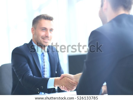 businessman shaking hands to seal a deal with his partner #526133785