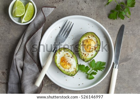 avocado baked with eggs, top view #526146997