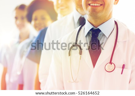 health care, profession, people and medicine concept - close up of happy doctors with stethoscope at hospital Royalty-Free Stock Photo #526164652