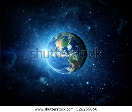 Earth, galaxy and sun. Elements of this image furnished by NASA. Royalty-Free Stock Photo #526255060