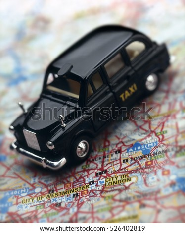 LONDON TAXI CAB WITH MAP ON LONDON #526402819