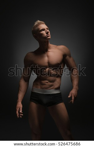 Advertising underwear. Photo of sexy man in briefs #526475686