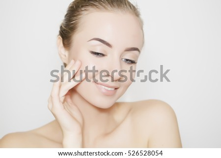 Health and beauty concept - beautiful young woman face on white with vivid shadow #526528054