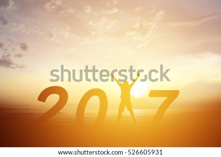 Silhouette man jumping on the sea and 2017 years while celebrating new year #526605931