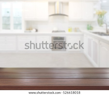 Table Top And Blur Kitchen Room Of The Background #526618018