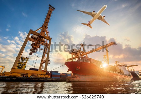 Logistics and transportation of Container Cargo ship and Cargo plane with working crane bridge in shipyard, logistic import export and transport industry background Royalty-Free Stock Photo #526625740