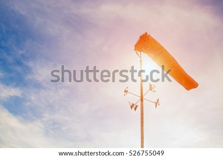 wind sock in the sky ,pastel colors style. Royalty-Free Stock Photo #526755049