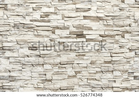Seamless texture, background, stone lined with granite walls. sandstone. stone background wall.  Facing Stone