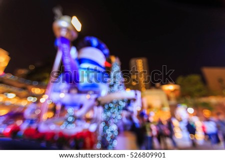 Bokeh lights with christmas tree and snowman in hong kong night #526809901