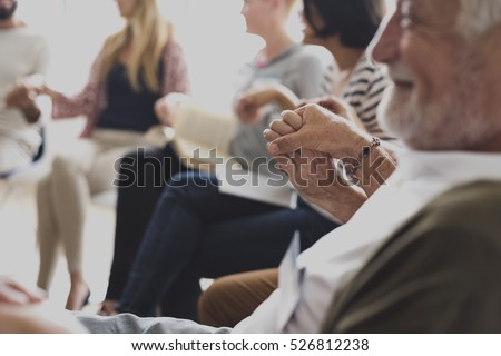 People in a counseling holding hands #526812238