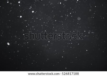 Falling snow on black background #526817188