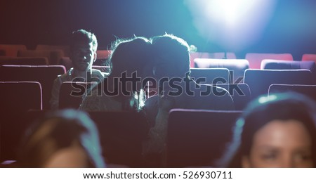 Young romantic loving couple kissing at the cinema, relationships and lifestyle concept #526930711