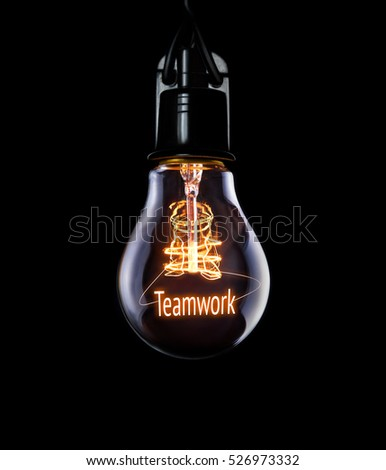 Hanging lightbulb with glowing Teamwork concept. #526973332