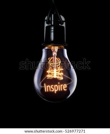 Hanging lightbulb with glowing Inspire concept. #526977271