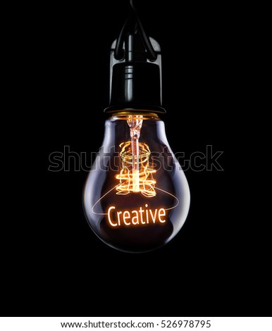 Hanging lightbulb with glowing Creative concept. #526978795