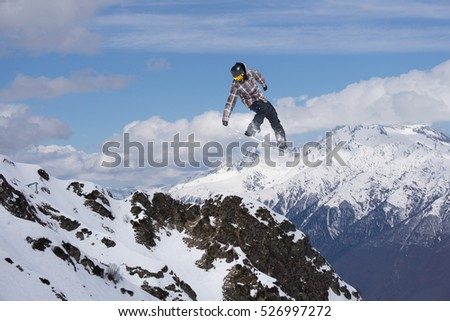 Flying snowboarder on mountains. Extreme sport. #526997272