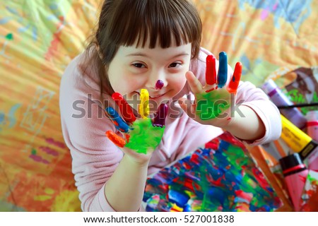Cute little girl with painted hands Royalty-Free Stock Photo #527001838