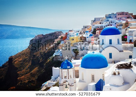 Oia, traditional greek village of Santorini with blue domes of churches, Greece, retro toned #527031679