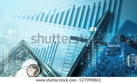 Double exposure of city and pen, calculator , money , graph for finance and business concept Royalty-Free Stock Photo #527098861