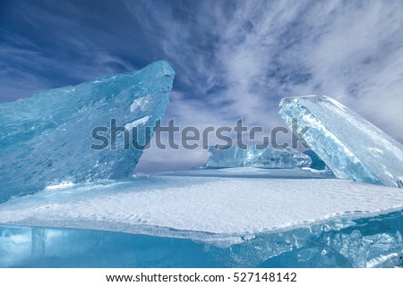 Construction with blocks of blue ice on sky background