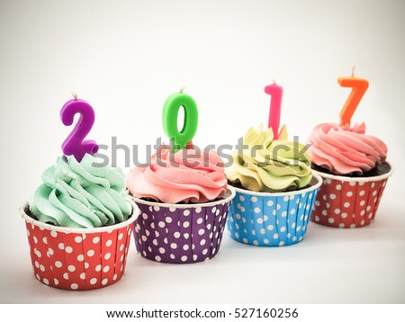 Retro color image, Chocolate cupcakes in rows with candles 2017, Selective focus (cake, new year, holiday)