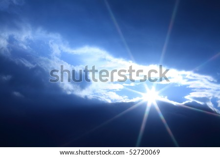A star shape sun shining brightly through the clouds