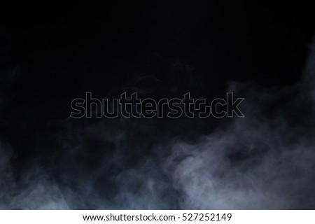 smoke on blackbackground Royalty-Free Stock Photo #527252149