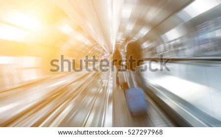 blurred passengers using a skywalk/staircase at a airport #527297968