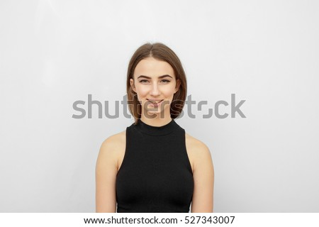 Young beautiful cute girl showing different emotions. Background for the girl a concrete gray wall. Laughing, smiling, anger, suspicion, fear, surprise. #527343007