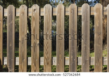 Wooden fence forbidding the access to nature. #527362684
