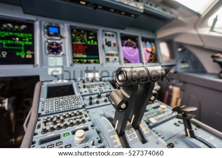 Closeup high detailed view on engine power control and other aircraft control unit in the cockpit of modern civil passenger airplane  Royalty-Free Stock Photo #527374060