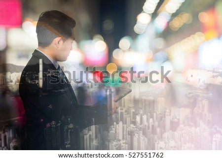 Abstract blur background.Double exposure of Young Asian businessmen and city. business freedom concept. #527551762