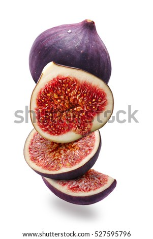 Fig fruits (Ficus carica), whole, halves and slices, vertical arranged. Clipping paths, shadow separated #527595796