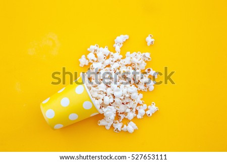 pop corn in a vase in yellow background.top view.Minimalist Royalty-Free Stock Photo #527653111