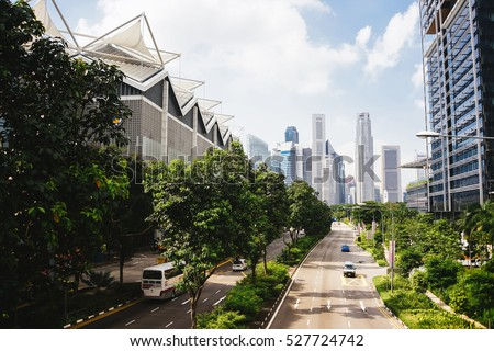 Green city of the future. City of the future. Harmony of city and nature. Sunny day in the big city. Deserted quarter, streets without people #527724742