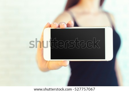 Woman with modern mobile phone in hands  #527757067