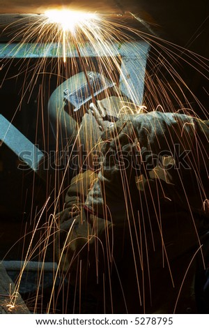 welder working at night has sparks fly #5278795