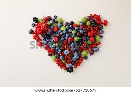 Fresh organic berries heart, healthy lifestyle #527910679