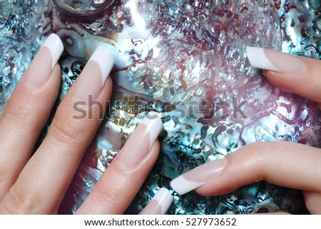 Female  hands with beautiful french manicure #527973652