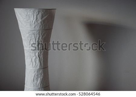 paper lamp and its shadows on white wall #528064546