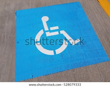 blue wheelchair symbol in parking space #528079333