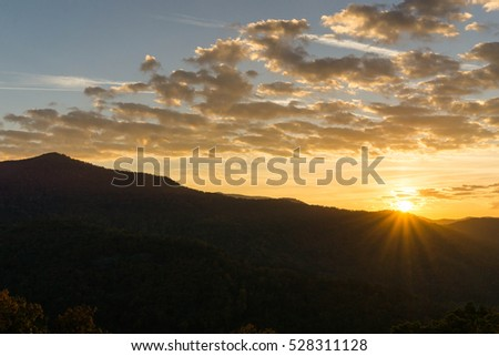 sunrise and clouds over the Appalachian Mountains on the Blue Ridge Parkway in western North Carolina #528311128