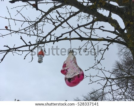 Christmas tree decoration on the tree outside. Snow  background #528337141