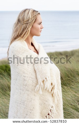 Young Woman Standing In Sand Dunes Wrapped In Blanket #52837810