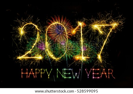 HAPPY NEW YEAR 2017 from colorful sparkle on black background Fireworks light up the sky,New Year celebration fireworks