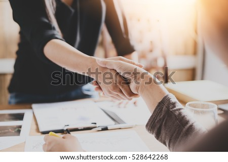 Negotiating business,Image of businesswomen Handshaking,happy with work,the woman she is enjoying with her workmate,Handshake Gesturing People Connection Deal Concept Royalty-Free Stock Photo #528642268