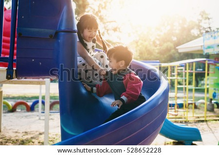 boy and girl on the playground Royalty-Free Stock Photo #528652228