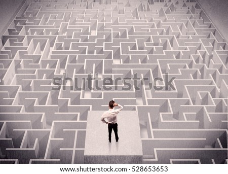 A confused businessman thinking while standing on a square platform above a detailed maze #528653653