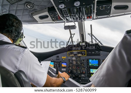 Interior details of a water plane with pilot and co pilot on board while flying. The photography is a demonstration of team work. #528760099