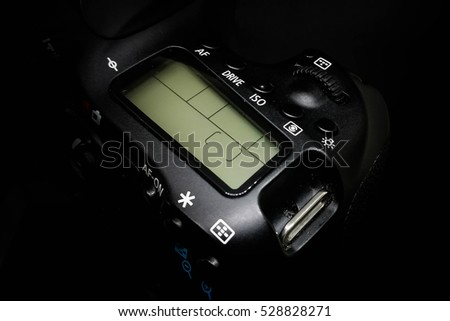 LED display on a DSLR camera, close up image isolated on black background #528828271